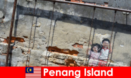 La street art affascinante e diversificata nell'isola di Penang stupisce gli estranei